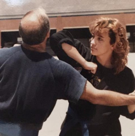 Author & her father in 1986 doing some outside training