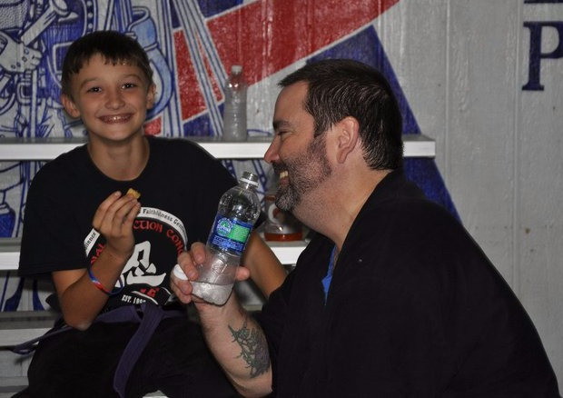 Author's son and another student enjoying a break during a seminar