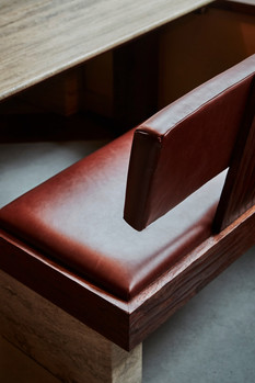 Detail of the benches in silver travertine and hand-planed oak Photo credit: Charlie Mckay