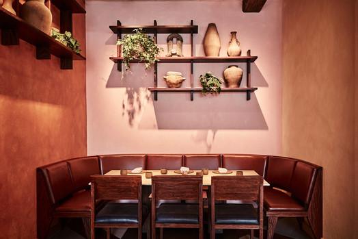 Kol dining room - Corner seating with bespoke modernist upholstered seating Photo credit: Charlie Mckay