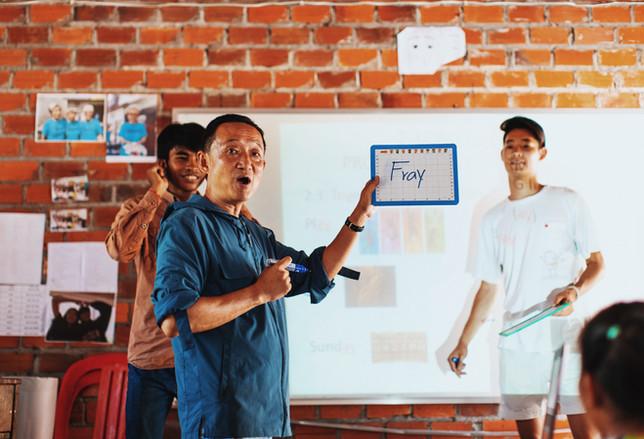 Teacher Joji teaching a class in Samrang.
