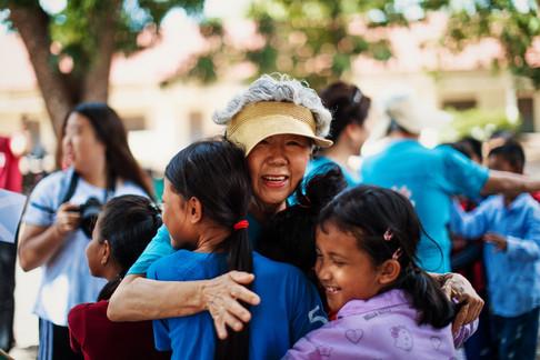 Grandma Kim greeting TASSEL students.
