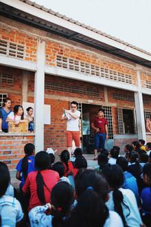 Teacher Jonathan teaches the students how to brush their teeth.