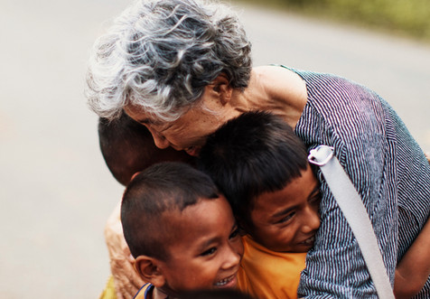 A group of kids run to Grandma Kim as she arrives in Cambodia for the very first time.  Backstory: Grandma Kim collects bottles in Los Angeles, recycles them and sends all the money to Cambodia. Joji relays the stories of the hard work of Grandma Kim and the kids are showing their appreciation for her work.