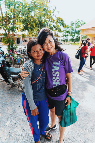 Teacher Ella with a student from the Samrang Village.