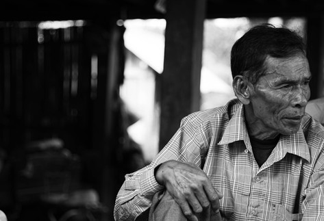 An ex-Khmer Rouge soldier expressing grief as he recounts his past experiences.