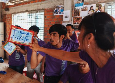 Teacher Leslie quizzing the Khmer teachers on grammar.