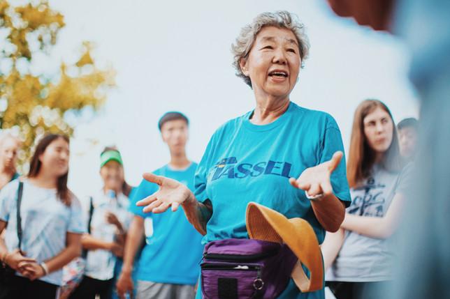 Grandma Kim addresses the students at Banan Village.