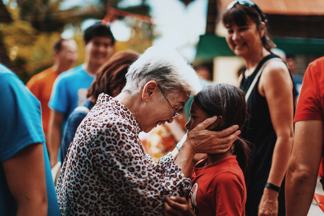 Grandma Soh has a moment with a young TASSEL student.