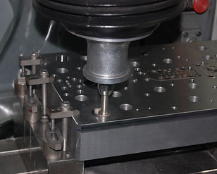 Jig Grinding process. Internal grindig for holes to achieve fine surface finish and accurate diameter or pitch tolerances.