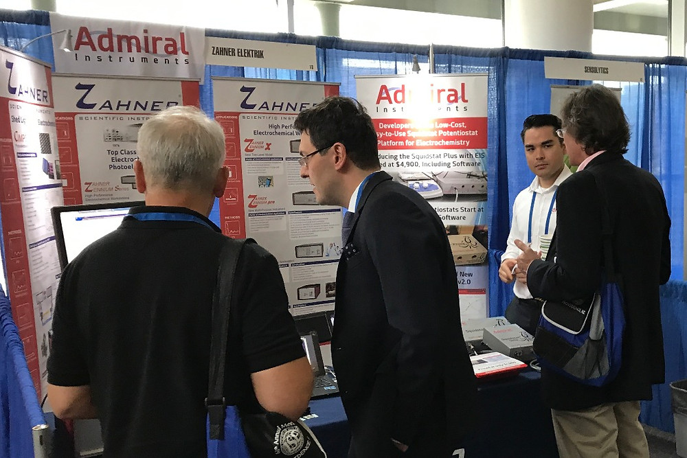 Mark and Sebastian speaking with conference attendees at our booth