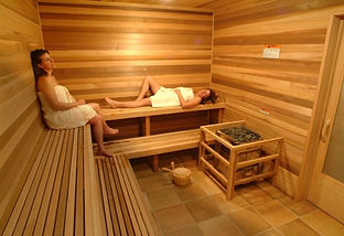 People relaxing in the sauna at Brooks Lake Lodge, an all inclusive resort in Dubois, WY