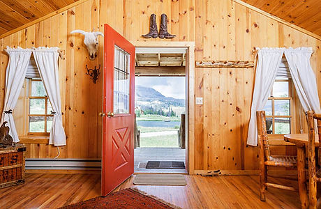 Open door at a cabin at Brooks Lake Lodge, an all inclusive resort in Dubois, WY
