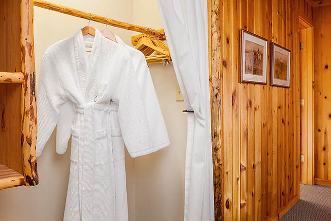 White bathrobe hangs in a closet at Brooks Lake Lodge, an all inclusive resort in Dubois, WY