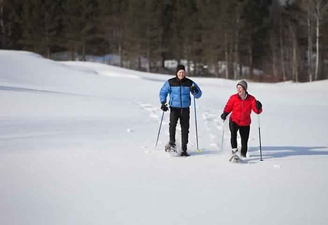 Guests snowshoe at Brooks Lake Lodge, an all-inclusive luxury resort near Yellowstone