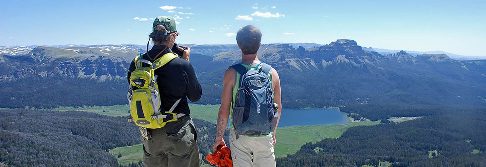 People take a photo of mountain landscape at Brooks Lake Lodge, an all-inclusive luxury resort near Yellowstone