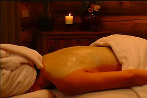 Person gets a massage treatment at Brooks Lake Lodge, an all inclusive resort in Dubois, WY