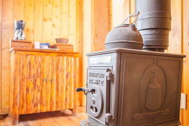 A wood-fire stove at Brooks Lake Lodge, an all inclusive resort near Yellowstone
