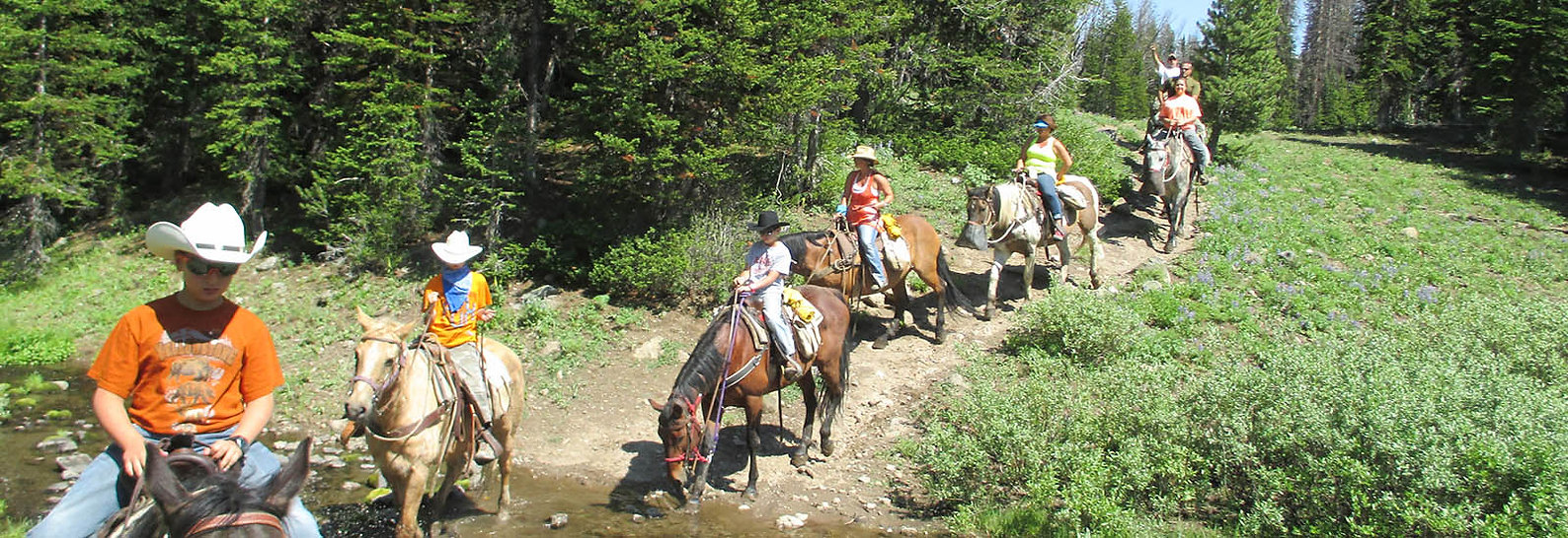 Guests horseback riding at Brooks Lake Lodge, an all inclusive resort in Dubois, WY