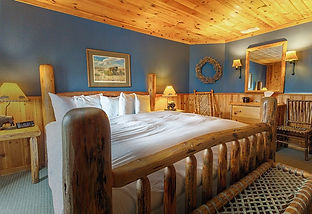 Cabin bedroom at Brooks Lake Lodge, an all inclusive resort in Dubois, WY