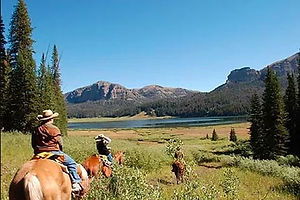 People on horseback riding out at Brooks Lake Lodge, an all inclusive resort in Dubois, WY