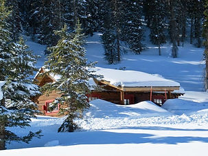 Snowy cabin at Brooks Lake Lodge, an all inclusive resort in Dubois, WY