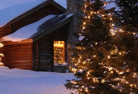 Snowy cabin for the holidays at Brooks Lake Lodge, an all-inclusive luxury resort near Yellowstone