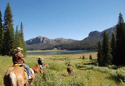 Guests on a trail ride at Brooks Lake Lodge, an all-inclusive luxury resort near Yellowstone