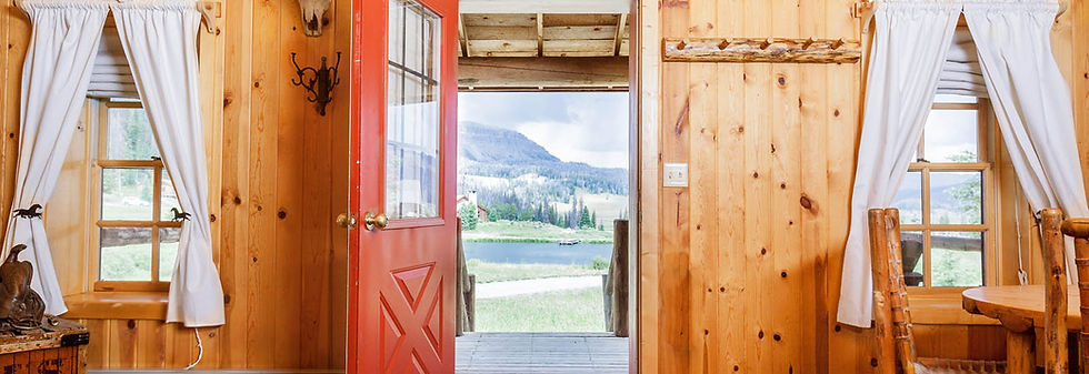 An open door at a cabin at Brooks Lake Lodge, an all inclusive resort in Dubois, WY