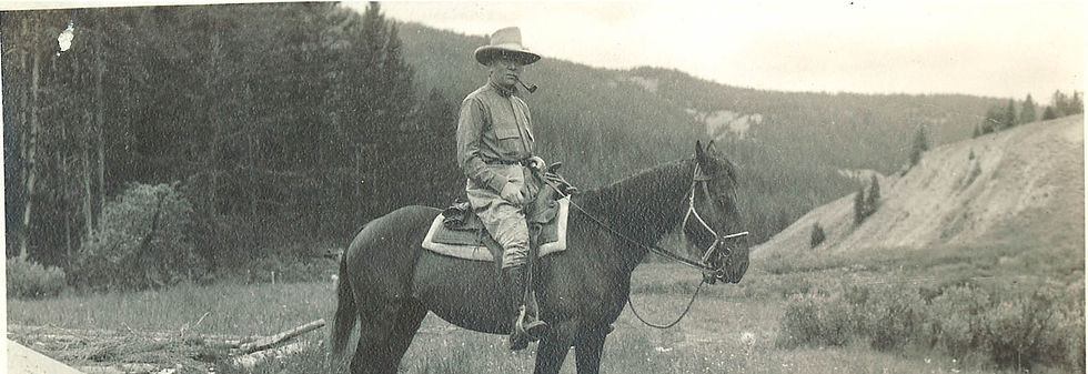 An historical photo of a man on horseback - Brooks Lake Lodge - mountain getaways