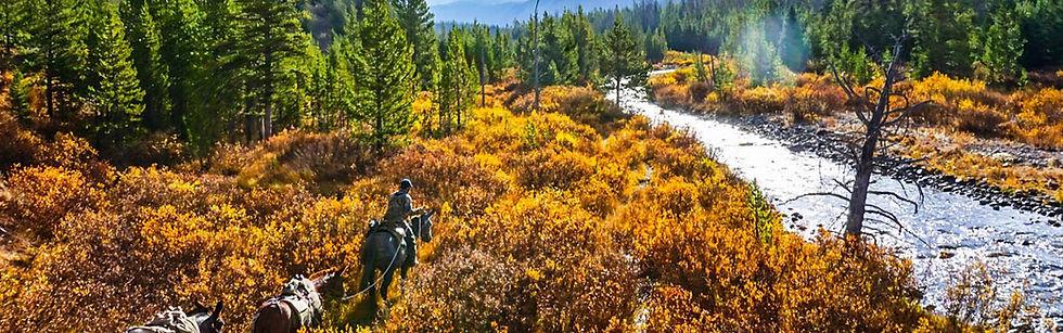 Hunter on horseback at Brooks Lake Lodge, an all-inclusive luxury resort near Yellowstone