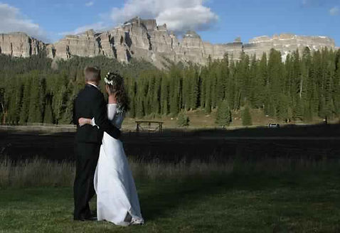 A bride and groom on their destination wedding at Brooks Lake Lodge, an all-inclusive luxury resort near Yellowstone