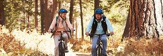 Older couple enjoying a bicycle ride