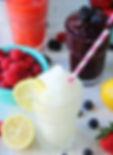 TheLemonadeBar-frzen-white-lemonade-smoothie-with-blurred-background-and-fruit