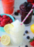 TheLemonadeBar-frzen-white-lemonade-smoothie-with-blurred-background-and-fruit
