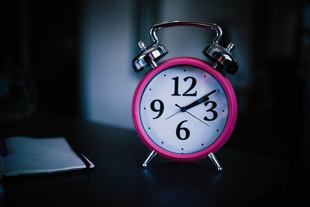 shows a pink clock