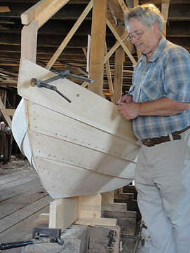 Current Master Dory Builder, Milford Buchanan, working on an unfinished dory.