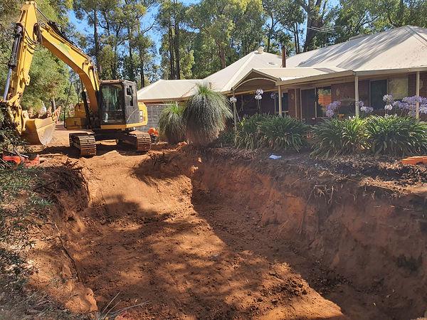 pool dig out rock breaking.jpg