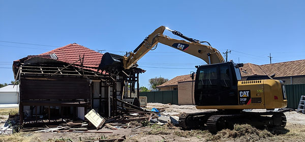 phc demolition wtih excavator.jpg