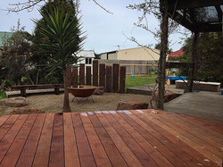 🌿Mornington Project featuring merbau decking, outback fire pit area with rustic fire pit and custom