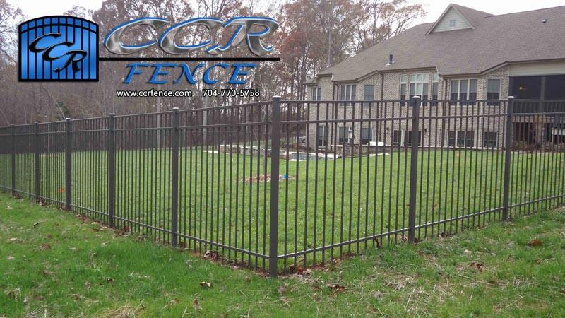Brown-Aluminum-Fencing-around-yard.jpg