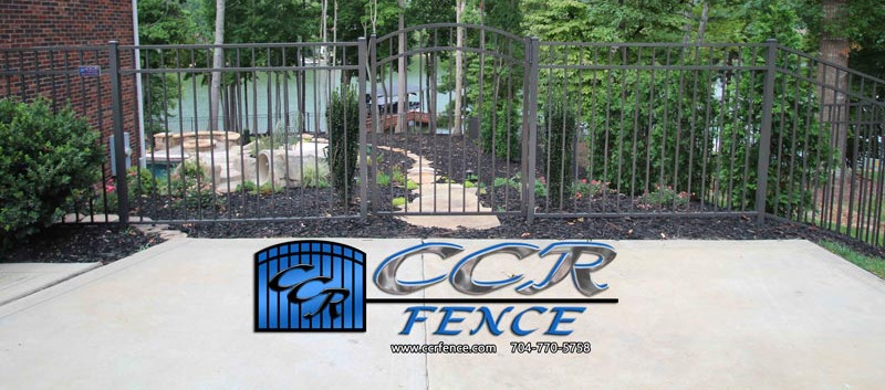Bronze-Aluminum-Fence-that-Blends-in-wit
