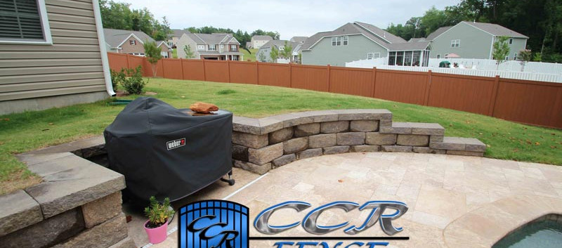 Brown-Vinyl-Privacy-Fence-around-Pool-an
