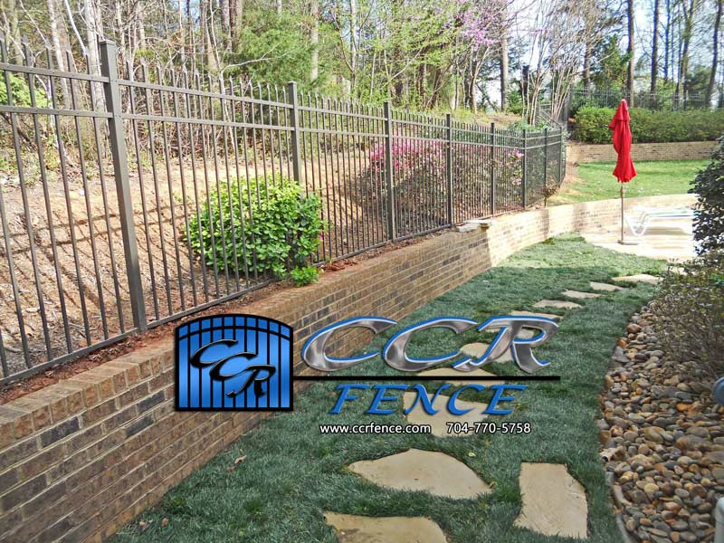 Aluminum-Fence-Installed-behind-a-Wall.j