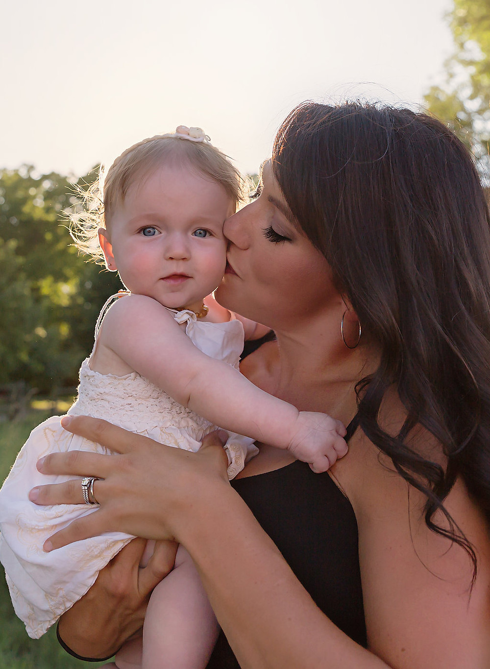 mommy kissing baby