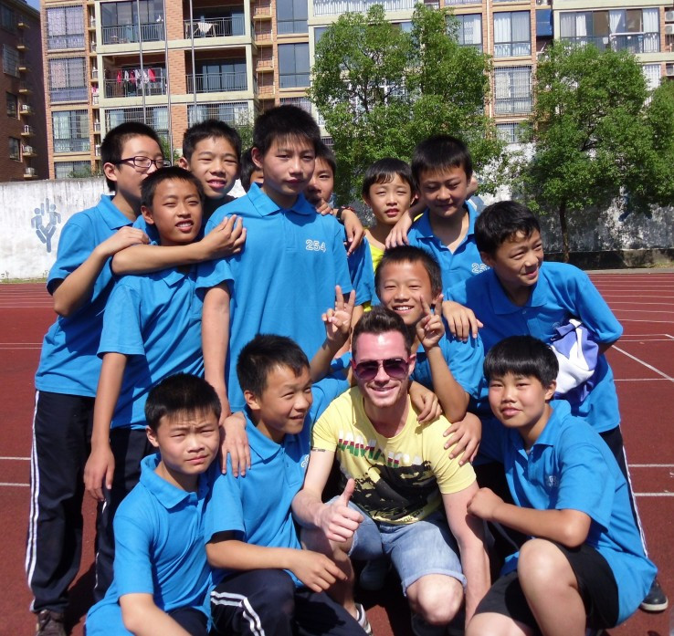 Evan with his students in China