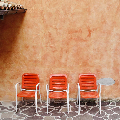 Orange chairs in Italy.
