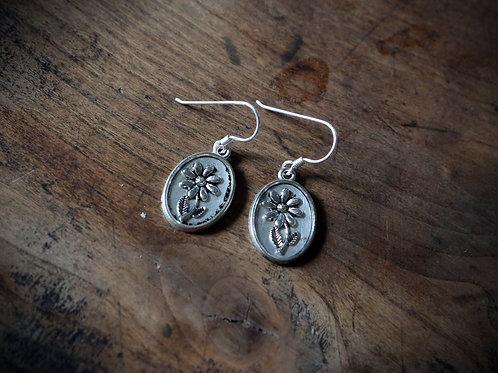 Boucle d'oreille Fleur métal