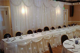 Back drop and top table curtain & swags with teinkle lights