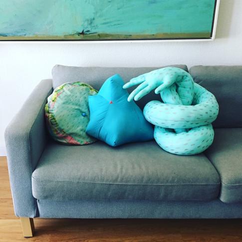 A trio of Jumbo Jibbles pillows: poof, blue gem, hug pillow